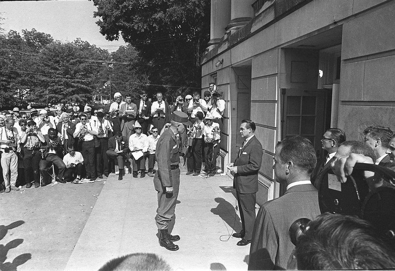 . National Guard Brig. Gen. Henry Graham, center,  informs Alabama Gov. George C. Wallace that the guard was under federal control as the two met at the door of Foster Auditorium at the University of Alabama in Tuscaloosa, Ala., June 11, 1963.  Wallace, who had vowed to prevent integration of the campus, gave way to federal troops. (AP Photo)