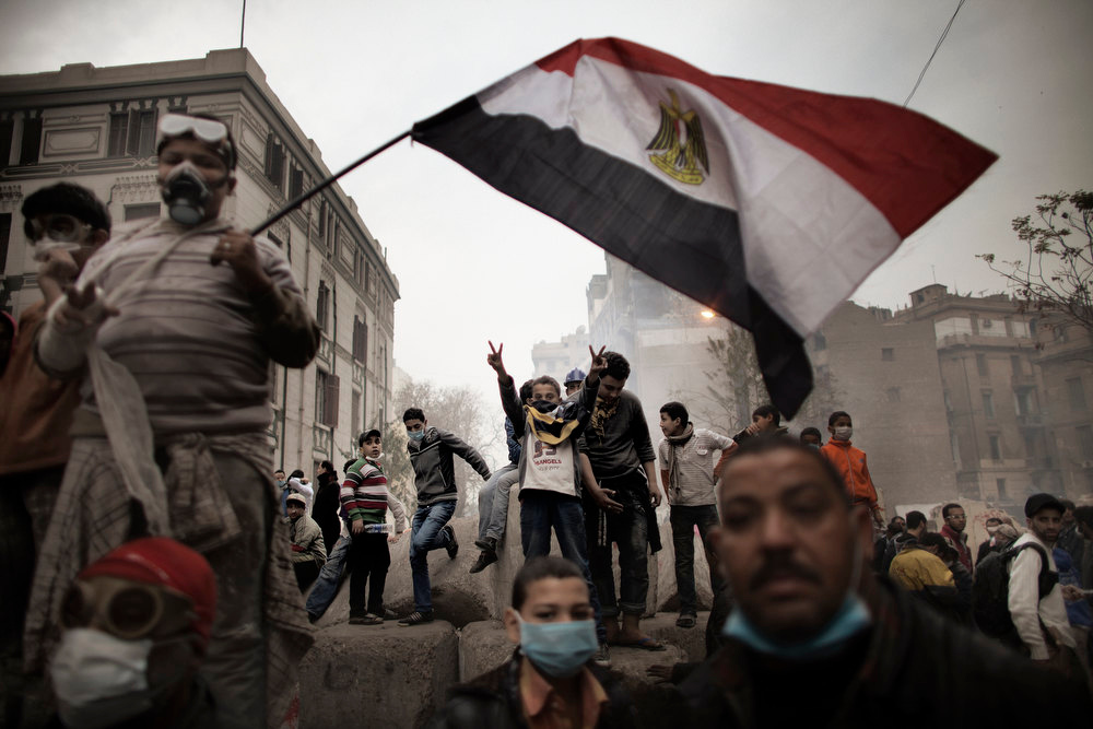 . Egyptian demonstrators gather next to a concrete block barricade during confrontations outside Cairo\'s security headquarters on February 6, 2012, as clashes continued in the Egyptian capital in the wake of deadly football violence and amid calls by activists for civil disobedience in Egypt.   MARCO LONGARI/AFP/Getty Images