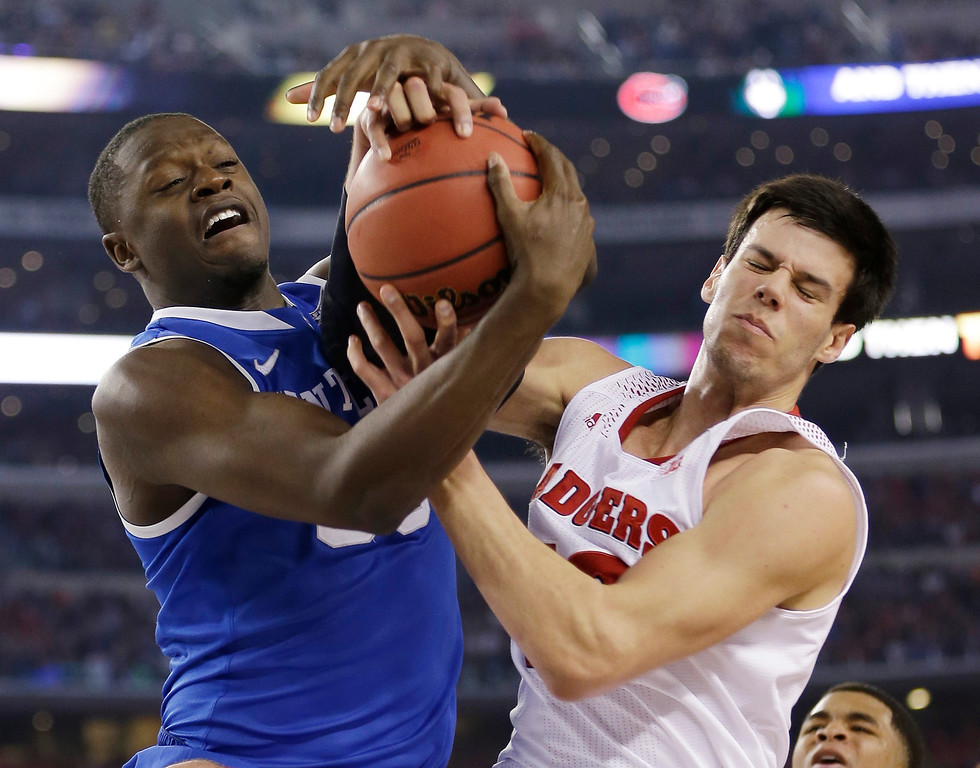 . Kentucky forward Julius Randle, left, fights for a rebound with Wisconsin forward Duje Dukan during the second half of an NCAA Final Four tournament college basketball semifinal game Saturday, April 5, 2014, in Arlington, Texas. (AP Photo/David J. Phillip)