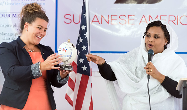 07/18/18 Wesley Bunnell | Staff The Sudanese American House celebrated its official opening today at its New Britain location including guest speakers, friends and city officials. Mayor Erin Stewart was presented with a decorated ostrich egg from Sudan as she stands next to the Sudanese American House's Head of Family and Child Affairs Dr. Fawatih Muhamed-Abouh.