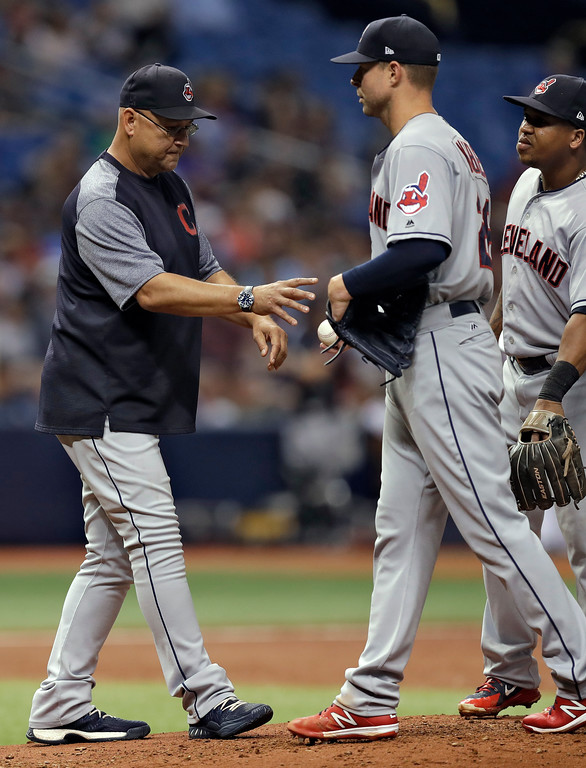 . Cleveland Indians manager Terry Francona, left, takes the ball from pitcher Corey Kluber as he is taken out of the game against the Tampa Bay Rays during the second inning of a baseball game Monday, Sept. 10, 2018, in St. Petersburg, Fla. (AP Photo/Chris O\'Meara)