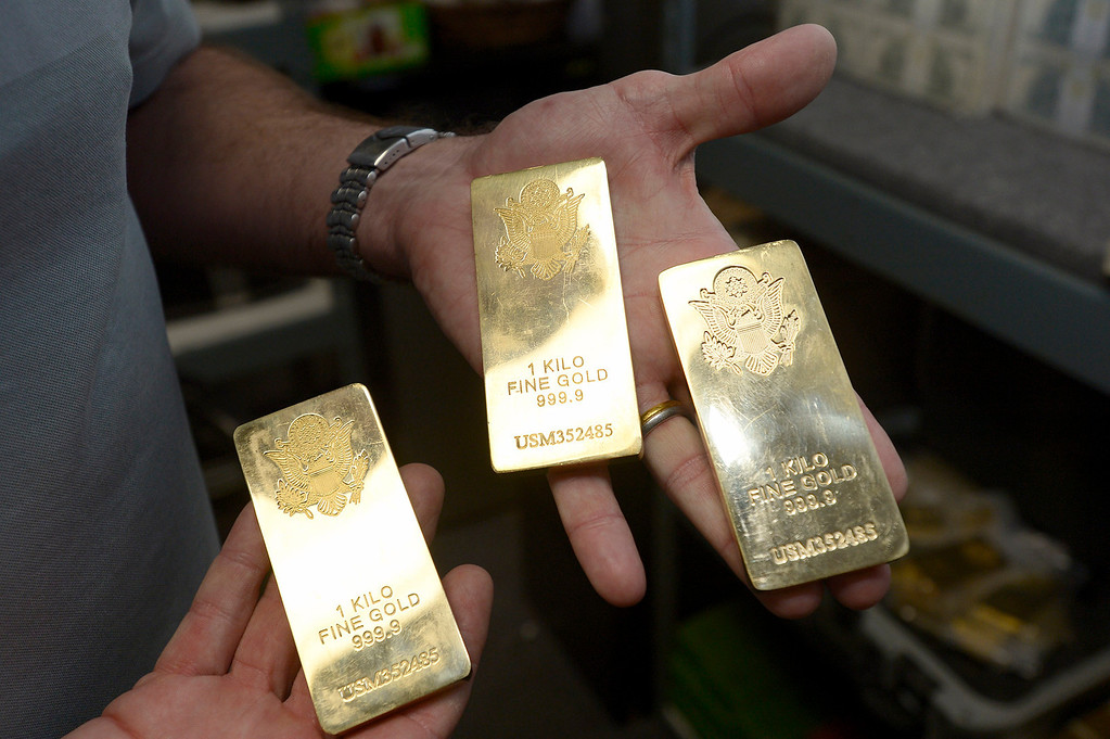. Fake gold bars made of brass. Gregg Bilson, Jr. is the CEO of ISS Independent Studio Services, a prop house that holds hundreds of thousands of items used for motion pictures and television production. Runaway production has an impact on his business. Sunland, CA 12-31-2013. photo by (John McCoy/Los Angeles Daily News)