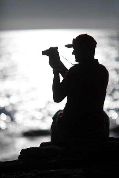 Visitor with a video camera, Cote Sauvage (Wild Coast), Quiberon, departament de Morbihan, Brittany, France