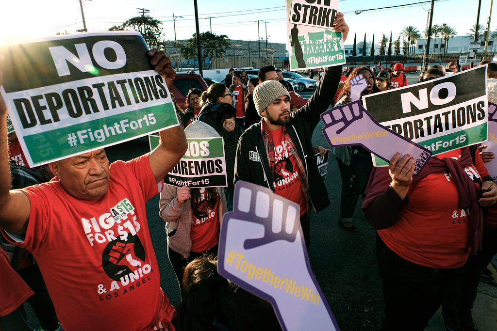 ". Protesters carrying signs and chanting slogans march during a protest in downtown Los Angeles on Tuesday, Nov. 29, 2016. A few dozen protesters blocked a downtown Los Angeles intersection as part of a national wave of demonstrations in support of higher wages and workers\' rights. Police stood by as the peaceful demonstrators formed a circle in the street early Tuesday while hoisting signs saying ""the whole world is watching\"" and \""Fight for $15.\"" (AP Photo/Richard Vogel)"
