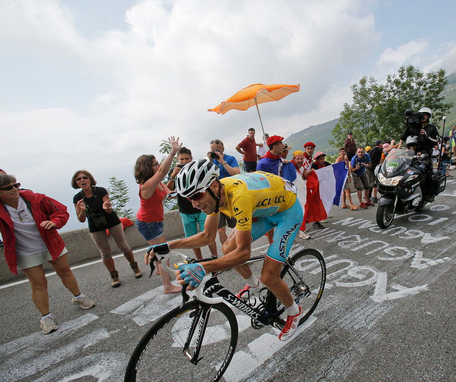 . Stage winner Vincenzo Nibali of Italy climbs towards Hautacam after breaking away from his rivals during the eighteenth stage of the Tour de France cycling race over 145.5 kilometers (90.4 miles) with start in Pau and finish in Hautacam, Pyrenees region, France, Thursday, July 24, 2014. (AP Photo/Christophe Ena)