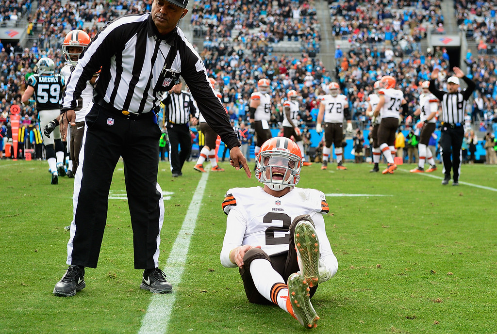 . CHARLOTTE, NC - DECEMBER 21:  Johnny Manziel #2 of the Cleveland Browns reacts after being hit by Luke Kuechly #59 of the Carolina Panthers during their game at Bank of America Stadium on December 21, 2014 in Charlotte, North Carolina.  (Photo by Grant Halverson/Getty Images)