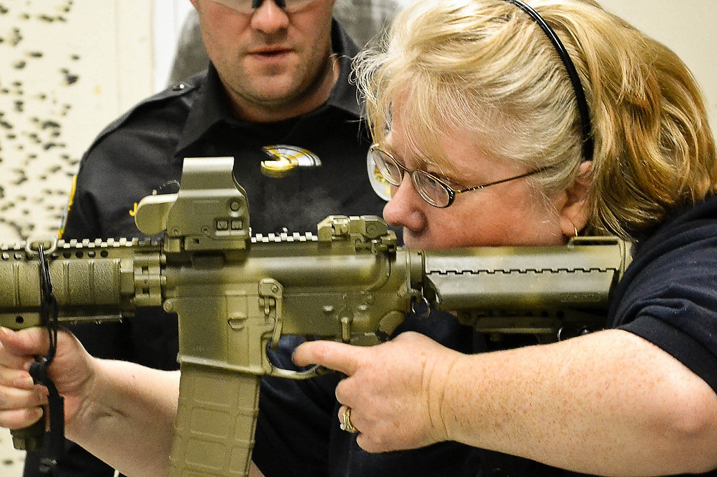 . Holly Wardlaw went through the St. Paul Citizens Police Academy. She\'s seen here shooting the M16. She was also tazed. (Courtesy photo)