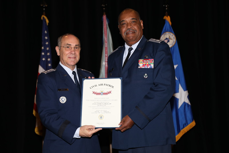 The Meritorious Service Award is presented to Lt Col Lazaro Garcia for service as the National Commander Aide de Camp.  Photo by Susan Schneider, CAPNHQ