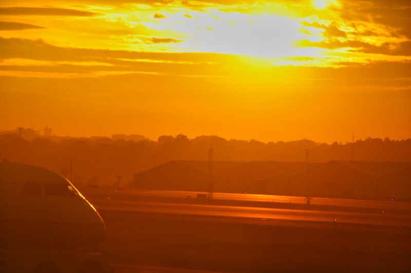 Sunset at  an airport with airplane in background