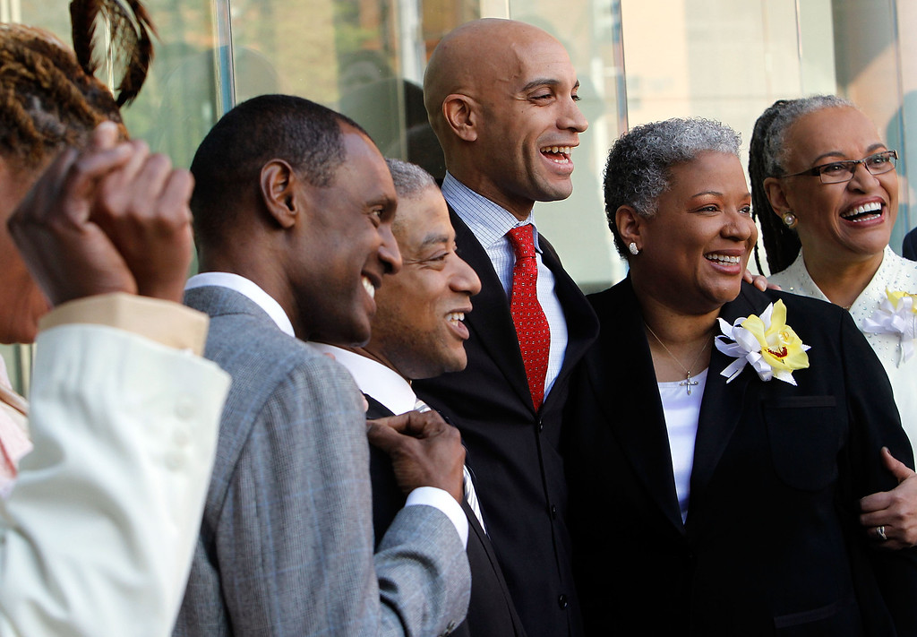 . WASHINGTON - MARCH 09:  WASHINGTON - MARCH 09:  DC Mayor Adrian Fenty (C) poses for photos with newly wed couples, (L-R) Rocky Galloway, Reggie Stanley, Candy Holmes and Darlene Garner after their weddings on the first day same-sex couples are legal to wed under a new law March 9, 2010 in Washington, DC. The District of Columbia has become the sixth in the nation to recognize same-sex marriage.  (Photo by Alex Wong/Getty Images)  (Photo by Alex Wong/Getty Images)