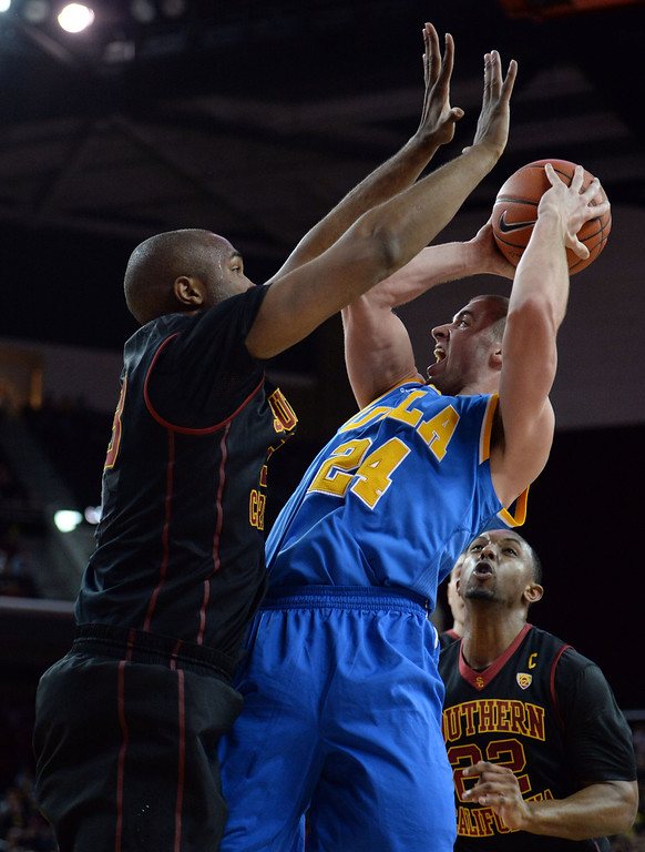 . UCLA\'s Travis Wear (24) shoots over Southern California\'s D.J. Haley (33) in the first half of a PAC-12 NCAA basketball game at Galen Center in Los Angeles, Calif., on Saturday, Feb. 8, 2014. (Keith Birmingham Pasadena Star-News)
