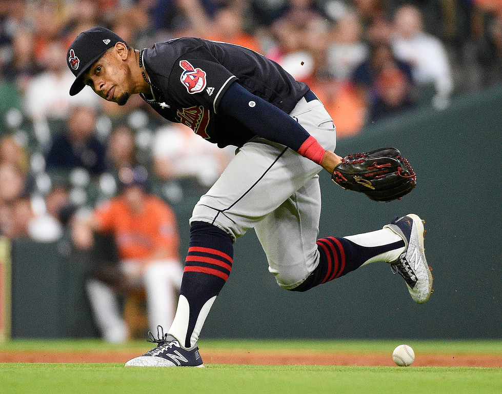 . Cleveland Indians shortstop Francisco Lindor misplays a grounder by Houston Astros\' Alex Bregman during the third inning of a baseball game Friday, May 18, 2018, in Houston. The play was ruled a hit. (AP Photo/Eric Christian Smith)