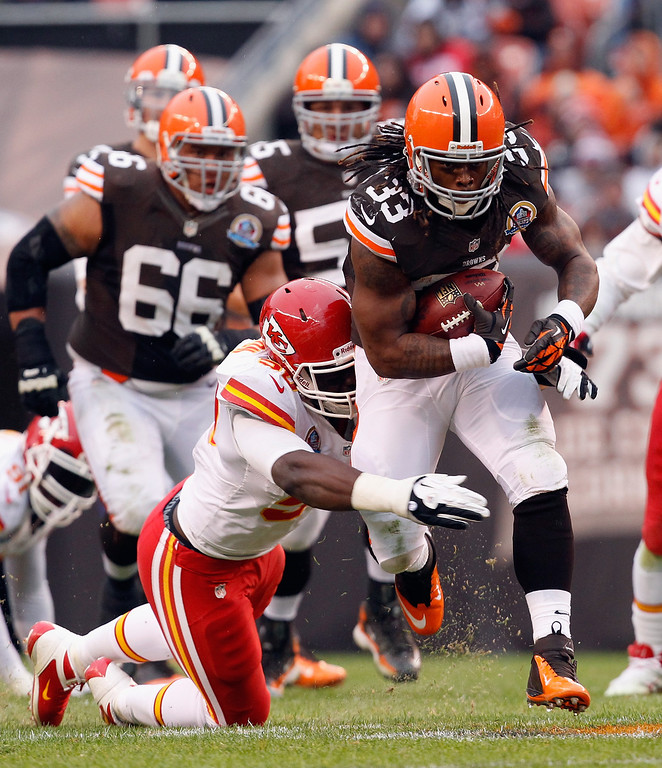 . CLEVELAND, OH - DECEMBER 09:  Running back Trent Richardson #33 of the Cleveland Browns runs the ball by linebacker Justin Houston #50 of the Kansas City Chiefs at Cleveland Browns Stadium on December 9, 2012 in Cleveland, Ohio.  (Photo by Matt Sullivan/Getty Images)
