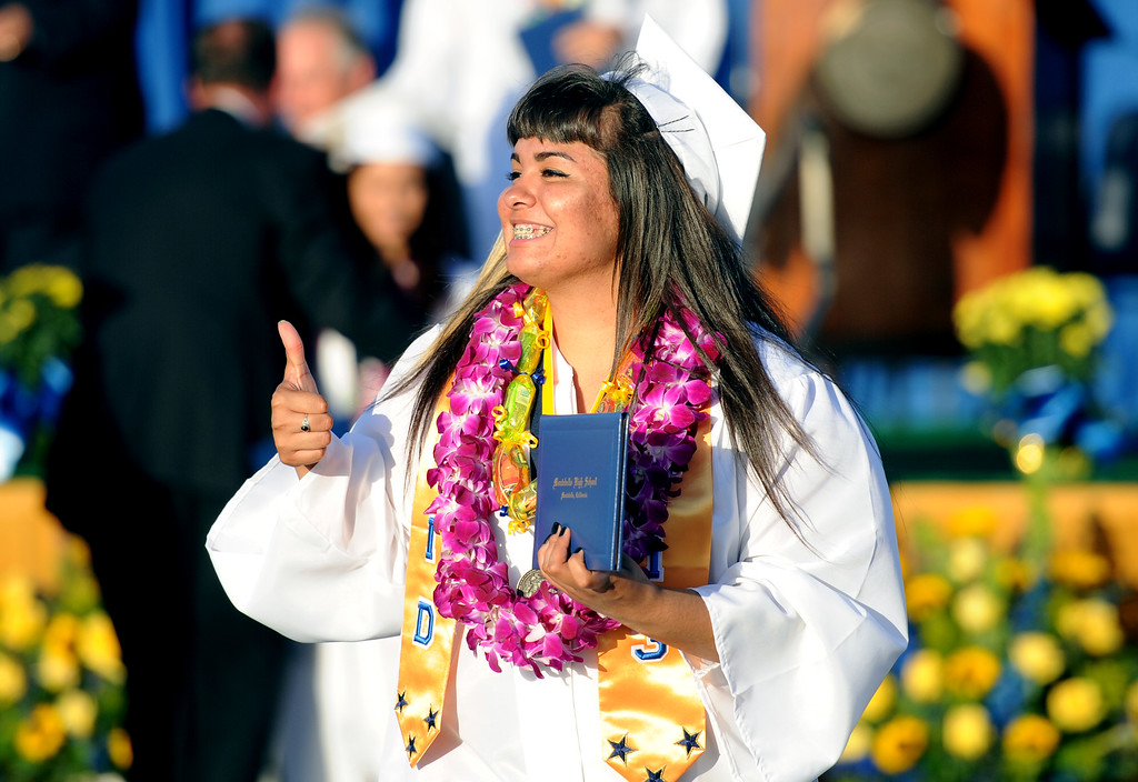 . A graduate gives the thumbs-up after receiving her diploma during the Montebello High School commencement at Montebello High School on Thursday, June 20, 2013 in Montebello, Calif.  (Keith Birmingham/Pasadena Star-News)