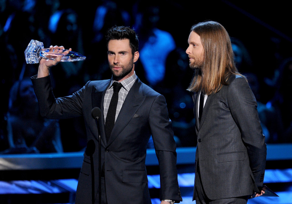 Description of . Musicians Adam Levine (L) and James Valentine of Maroon 5, winner of Favorite Band, speak onstage at the 39th Annual People's Choice Awards  at Nokia Theatre L.A. Live on January 9, 2013 in Los Angeles, California.  (Photo by Kevin Winter/Getty Images for PCA)