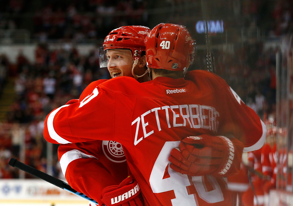 . Detroit Red Wings center Gustav Nyquist, left, celebrates his goal against the Tampa Bay Lightning with Henrik Zetterberg in the second period of an NHL hockey game in Detroit, Saturday, March 28, 2015. (AP Photo/Paul Sancya)