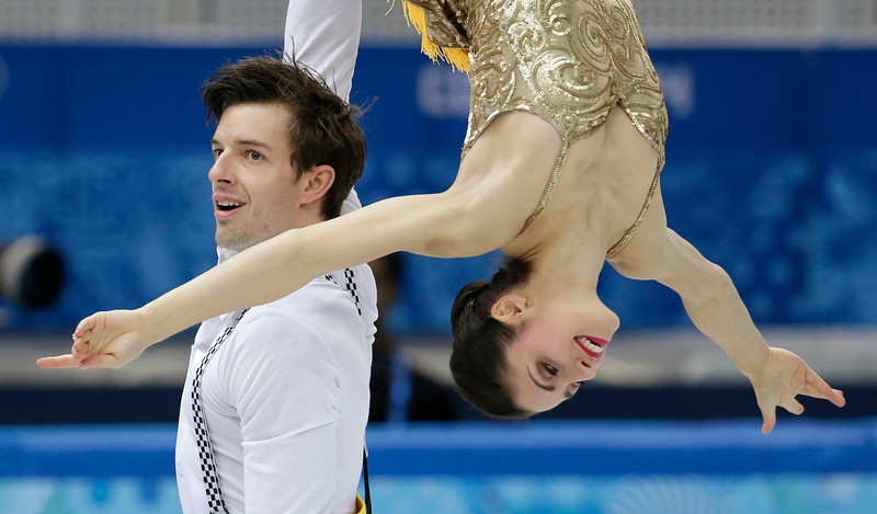 . Stefania Berton and Ondrej Hotarek of Italy compete in the team pairs short program figure skating competition at the Iceberg Skating Palace during the 2014 Winter Olympics, Thursday, Feb. 6, 2014, in Sochi, Russia. (AP Photo/Bernat Armangue)