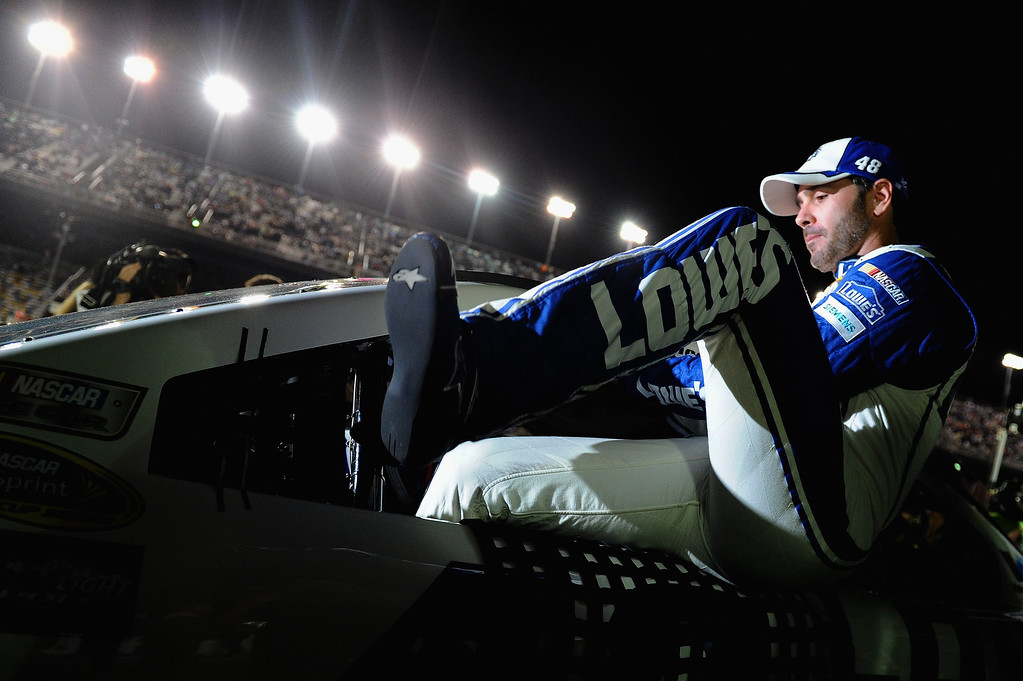 . Jimmie Johnson, driver of the #48 Lowe\'s Chevrolet, gets in his car before the start of the NASCAR Sprint Cup Series Budweiser Duel 2 at Daytona International Speedway on February 20, 2014 in Daytona Beach, Florida.  (Photo by Patrick Smith/Getty Images)