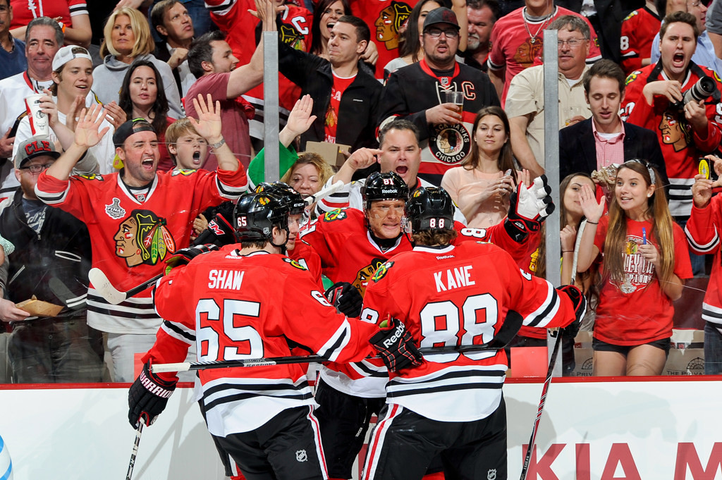 . Chicago\'s Marian Hossa, center, celebrates with teammates Andrew Shaw, left, and Patrick Kane, right, after scoring a short-handed goal against the Wild in the second period. (Photo by Bill Smith/NHLI via Getty Images)