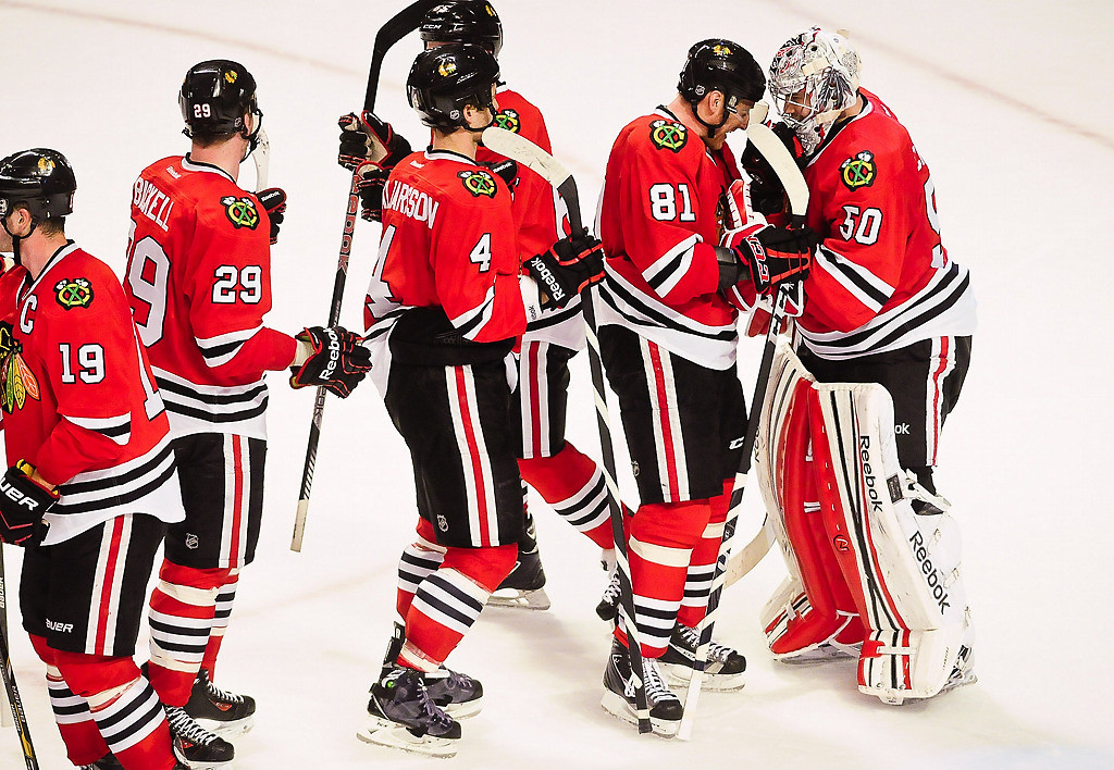 . Chicago Blackhawks players line up to greet goalie Corey Crawford after he had 26 saves in their 5-2 win. (Pioneer Press: Ben Garvin)
