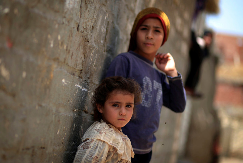 . Two Palestinian refugee children lean on the wall of a house in Gezirat al-Fadel village, Sharqiya, about 150 kilometers (93 miles) east of Cairo, Egypt.  (AP Photo/Khalil Hamra)