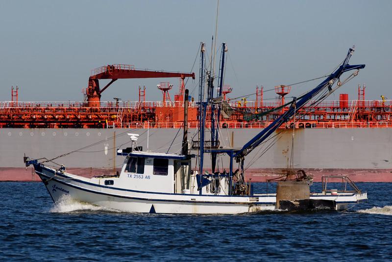 The shrimpboat Santana passes the Adama1.