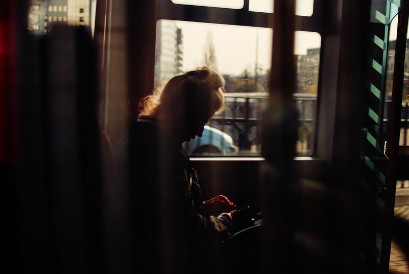 reflection tram woman sitting window ride warsaw warszawa poland spring nikon erik witsoe.jpg