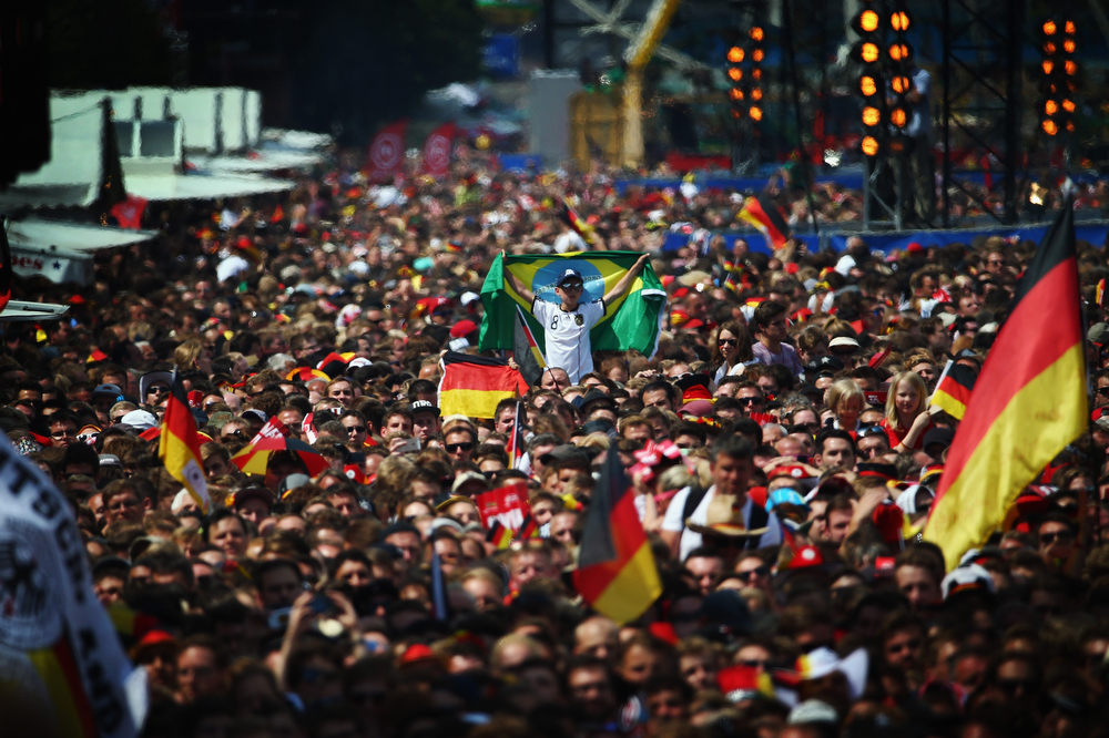 . Fans enjoy the atmosphere during the German team victory ceremony July 15, 2014 in Berlin, Germany. Germany won the 2014 FIFA World Cup Brazil match against Argentina in Rio de Janeiro on July 13.  (Photo by Alex Grimm/Bongarts/Getty Images)