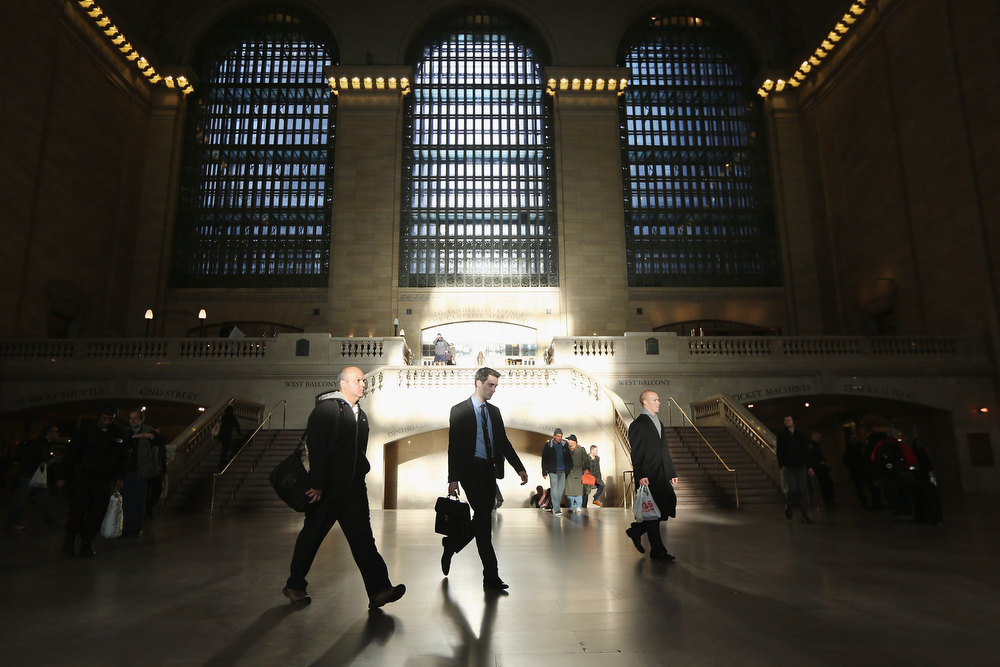 Description of . People walk through Grand Central Terminal during the morning rush in Manhattan on November 1, 2012 in New York City. (Photo by Mario Tama/Getty Images)