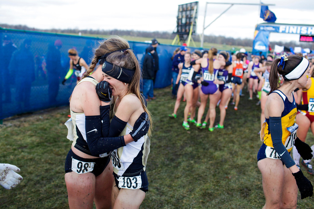 . TERRE HAUTE, IN - NOVEMBER 23: University of Colorado\'s Shalaya Kipp, left, comforts teammate Carrie Verdon, right, at the finish of the NCAA Cross County Championships at Lavern Gibson Championship Course on Saturday, November 23, 2013, in Terre Haute, Indiana. (Photo by Aaron P. Bernstein/Special to The Denver Post)