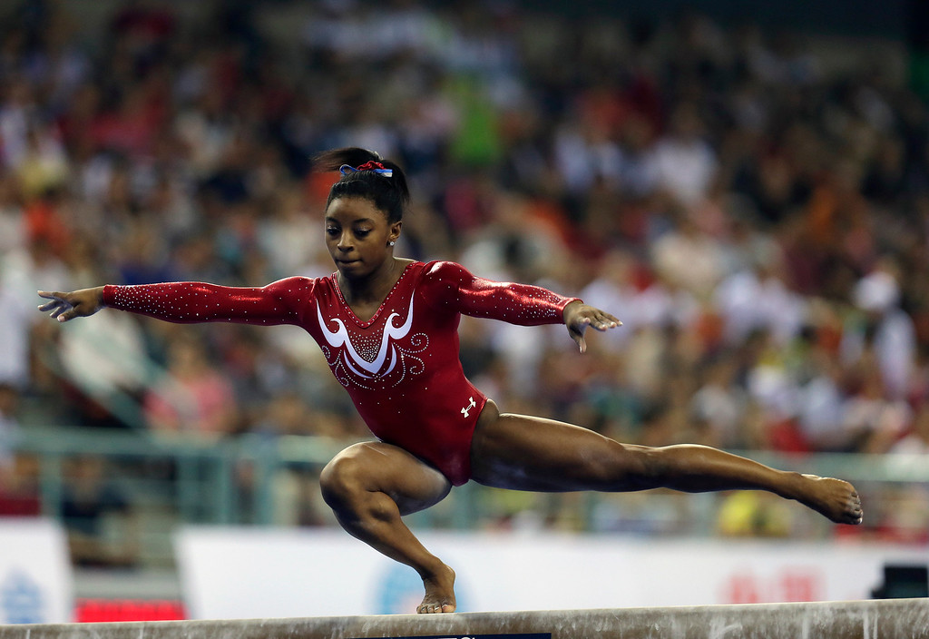 . Simone Biles of the United States performs on her balance beam routine during the women\'s team final of the Artistic Gymnastics World Championship at the Guangxi Gymnasium in Nanning, capital of southwest China\'s Guangxi Zhuang Autonomous Region Wednesday, Oct. 8, 2014. (AP Photo/Andy Wong)