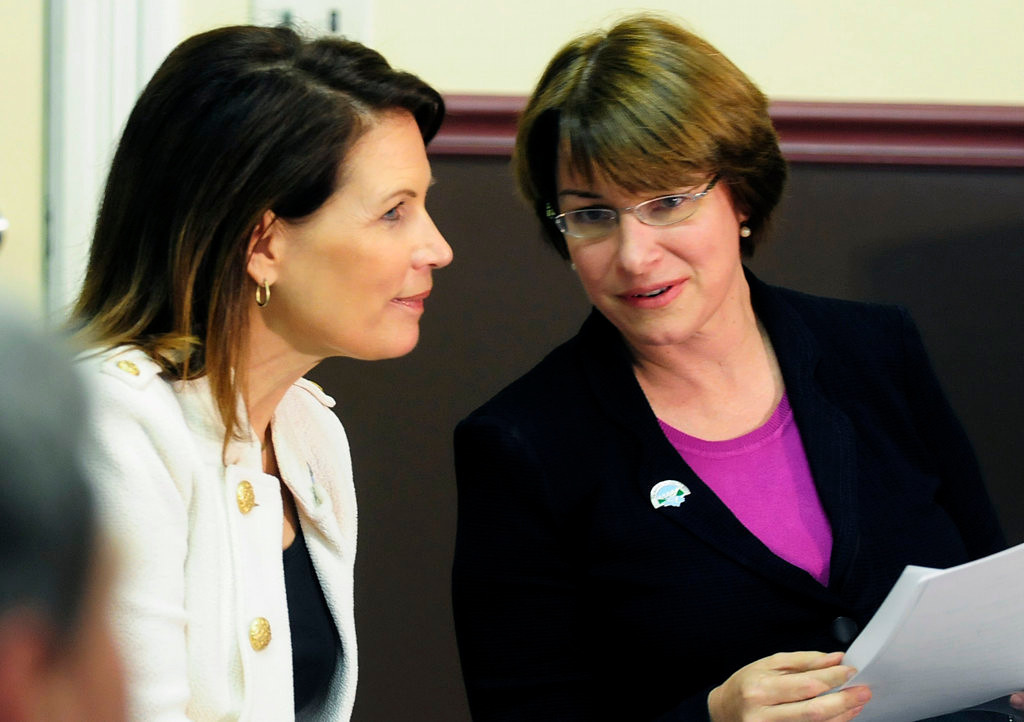 . U.S. Rep. Michele Bachmann, left, and U.S. Sen. Amy Klobuchar, both of Minnesota, chatted during the groundbreaking ceremony.  (Pioneer Press: Scott Takushi)