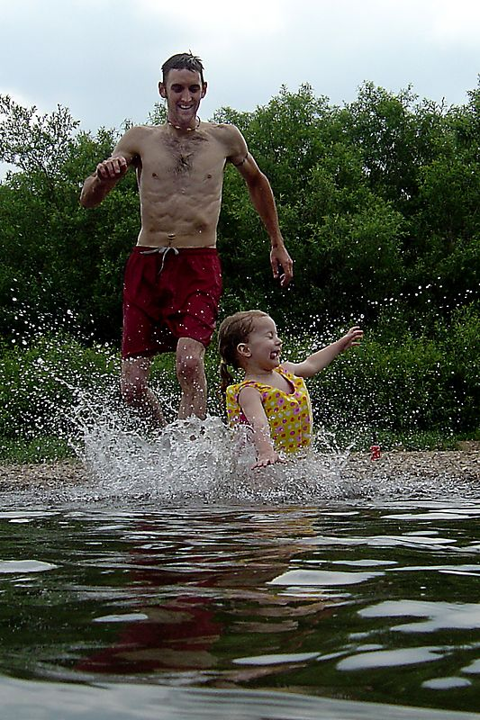 Mary makes a splash in the river.
