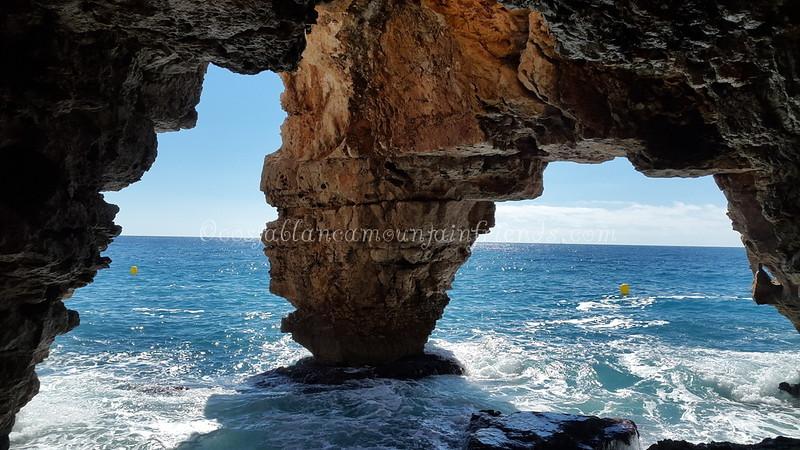 Sea caves at Cala del Moriag