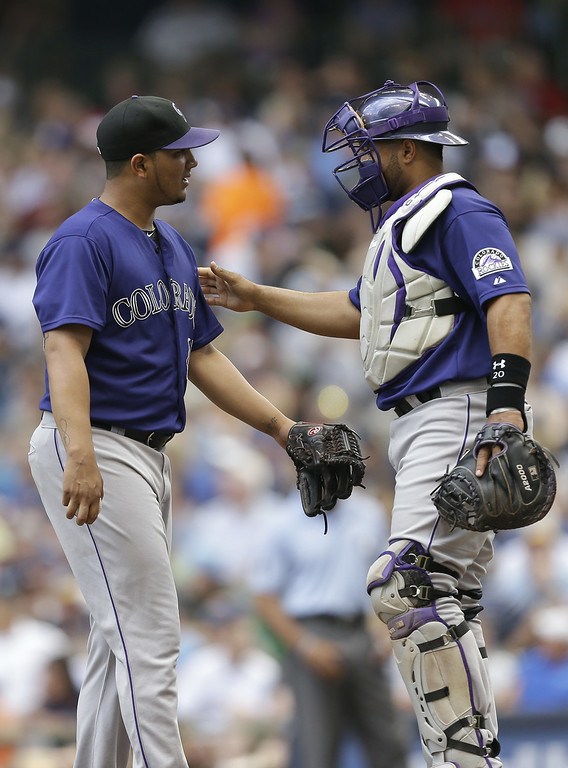 . MILWAUKEE, WI - JUNE 28: Jhoulys Chacin #45 of the Colorado Rockies talks to Wilin Rosario #20 during the second inning against the Milwaukee Brewers at Miller Park on June 28, 2014 in Milwaukee, Wisconsin. (Photo by Mike McGinnis/Getty Images)