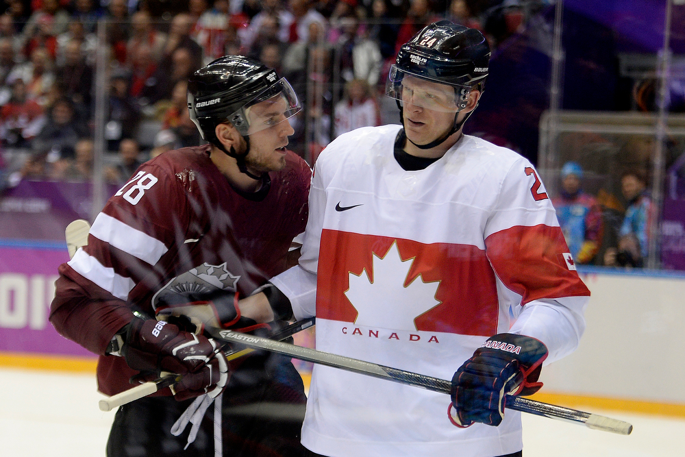 . Zemgus Girgensons (28) of the Latvia and Corey Perry (24) of the Canada get chippy during the third period of Canada\'s 2-1 win over Latvia. Sochi 2014 Winter Olympics on Wednesday, February 19, 2014 at Bolshoy Ice Arena. (Photo by AAron Ontiveroz/ The Denver Post)