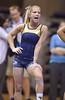 MORGANTOWN, WV - MARCH 8: WVU gymnast Lindsey Litten yells encouragement to a teammate in warmu-ups during a dual meet March 8, 2015 in Morgantown, WV.