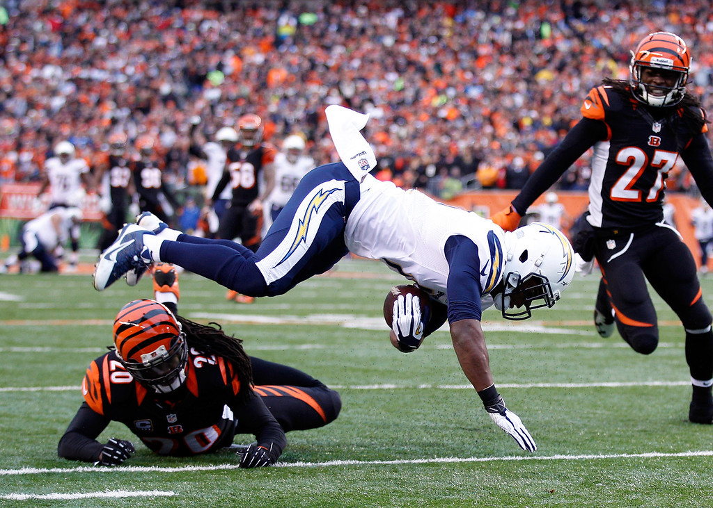 . Wide receiver Eddie Royal #11 of the San Diego Chargers is tackled by free safety Reggie Nelson #20 of the Cincinnati Bengals during a Wild Card Playoff game at Paul Brown Stadium on January 5, 2014 in Cincinnati, Ohio.  (Photo by Andy Lyons/Getty Images)