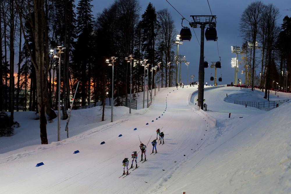 . Competitors ski during the men\'s biathlon 4x7.5K relay at the 2014 Winter Olympics, Saturday, Feb. 22, 2014, in Krasnaya Polyana, Russia. (AP Photo/Felipe Dana)