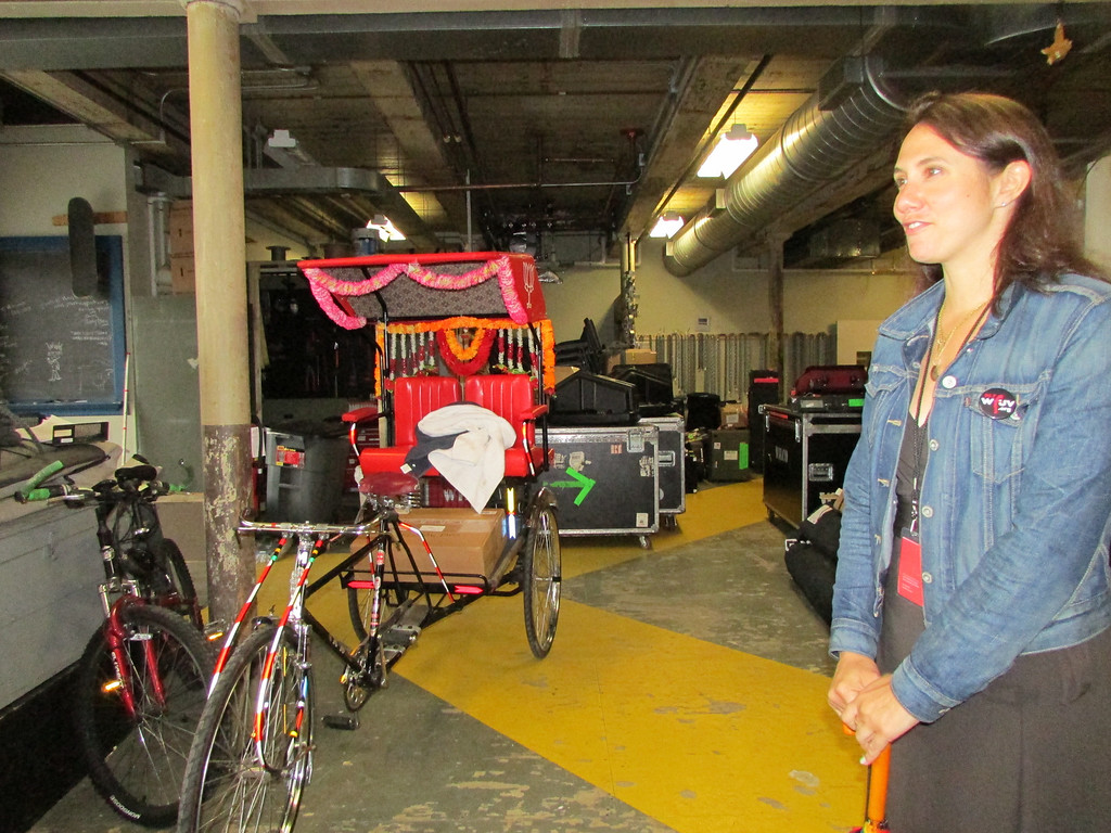 . Mass MoCA Communications Director Jodi Joseph talks about a rickshaw, designed by artist John Stirratt, that will be in use during Solid Sound Festival. (Jennifer Huberdeau/North Adams Transcript)