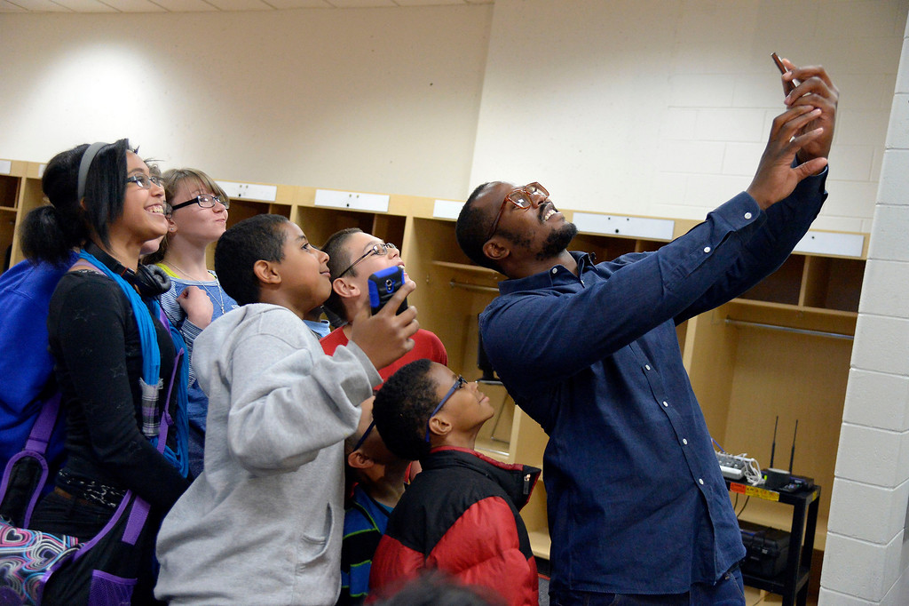 . Denver Broncos linebacker Von Miller takes a group selfie after a few students received their prescription glasses April 14, 2014. Miller\'s Foundation, Von\'sVision, distributed prescription glass to more than 100 underprivileged children at Sports Authority Field. (Photo by John Leyba/The Denver Post)