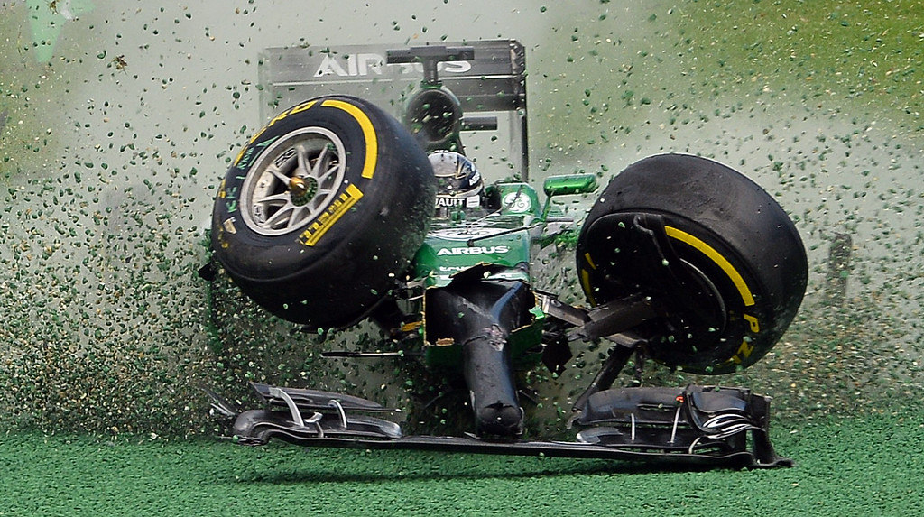 . The car of Caterham-Renault driver Kamui Kobayashi of Japan veers off the track during an accident at the start of the Formula One Australian Grand Prix in Melbourne on March 16, 2014. AFP PHOTO / Saeed KHAN /AFP/Getty Images