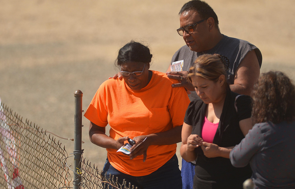. Family members and friends  gathered to view the scene where a quadruple fatal accident happened the night before at Fifth Street near Cooley Avenue in San Bernardino. The vehicle plunged 20 feet to the bottom of a concrete channel.Photo by LaFonzo Carter/ The Sun