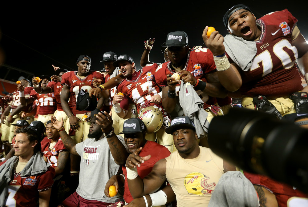 Description of . Florida State Seminoles celebrates after they won 31-10 against the Northern Illinois Huskies during the Discover Orange Bowl at Sun Life Stadium on January 1, 2013 in Miami Gardens, Florida.  (Photo by Streeter Lecka/Getty Images)