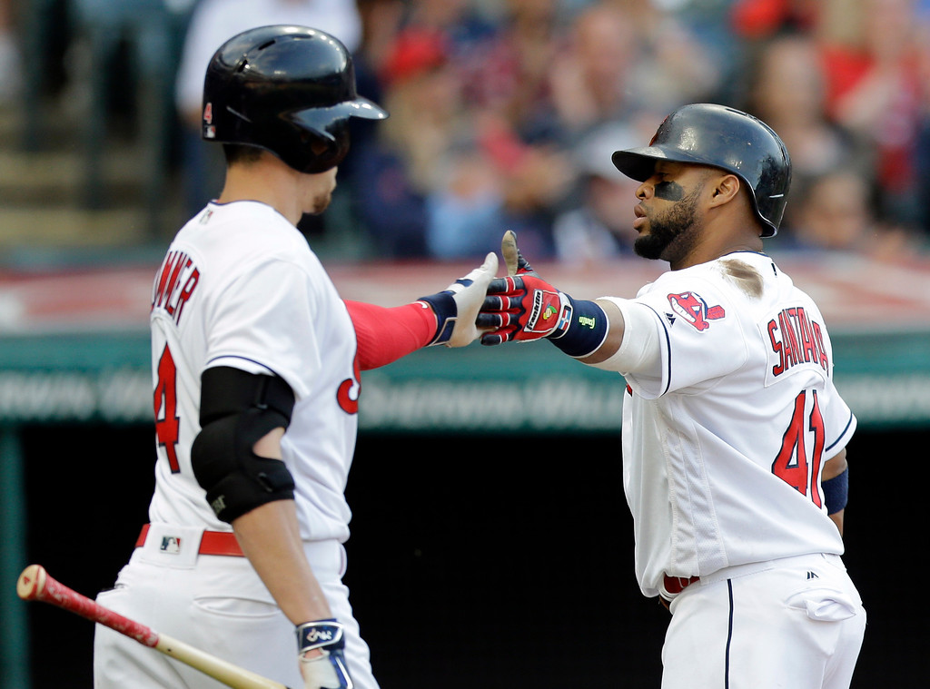 . Cleveland Indians\' Carlos Santana, right, is congratulated by Bradley Zimmer after Santana scored on a one-run double hit by Jose Ramirez in the fourth inning of a baseball game against the Oakland Athletics, Tuesday, May 30, 2017, in Cleveland. (AP Photo/Tony Dejak)