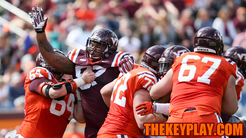 DT Tim Settle (97) is held by OL Eric Gallo (64) as he tries to get to the quarterback. (Mark Umansky/TheKeyPlay.com)