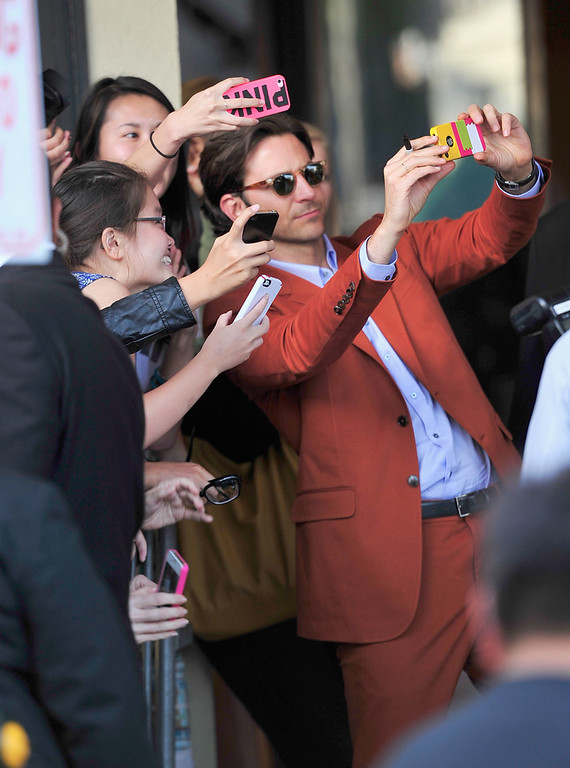 """. Actor Bradley Cooper attends the premiere of Warner Bros. Pictures\' \""""Hangover Part 3\"""" at Westwood Village Theater on May 20, 2013 in Westwood, California.  (Photo by Frazer Harrison/Getty Images)"""