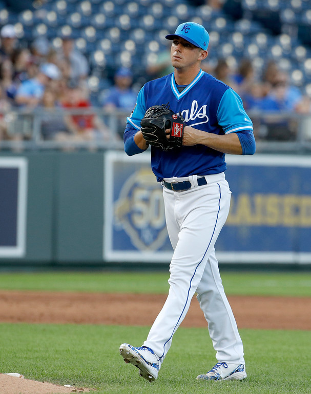 . Kansas City Royals starting pitcher Heath Fillmyer walks back to the mound after giving up a run on a balk during the second inning of a baseball game against the Cleveland Indians on Saturday, Aug. 25, 2018, in Kansas City, Mo. (AP Photo/Charlie Riedel)