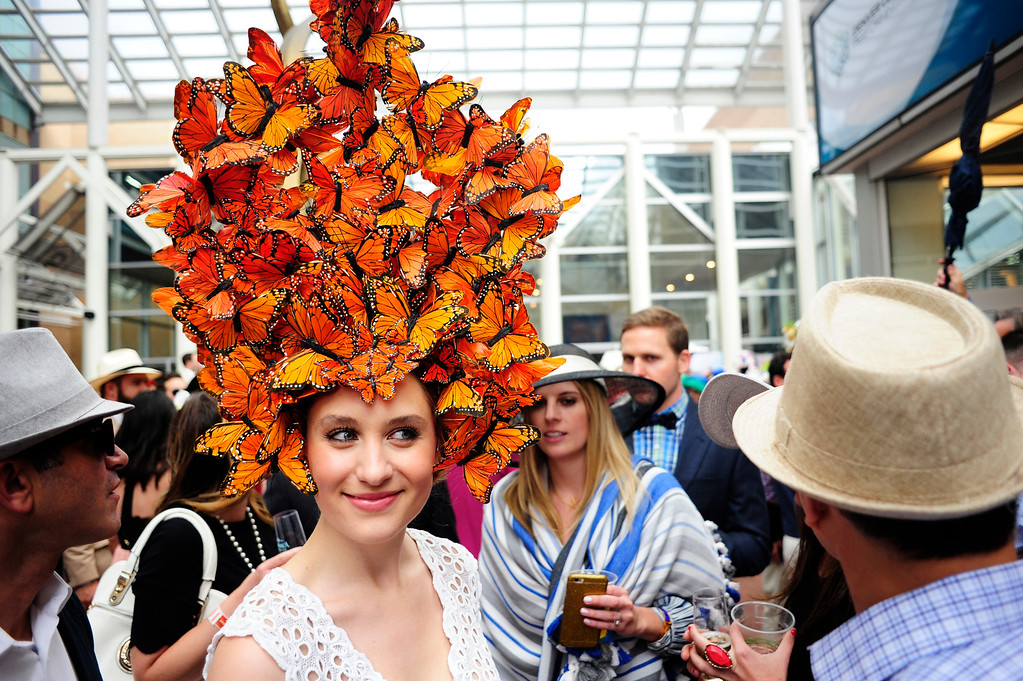 . Jillian Sternberg walks through the crowd sporting a butterfly-themed hat during the Denver Derby Party at the Performing Arts Complex in Denver, Colorado, Saturday, May 7, 2016. The event featured The Macy\'s Best Hat Contest, and also awarded 3 full-ride scholarships to students heading to Colorado State University. (Brenden Neville/Special to the Denver Post)
