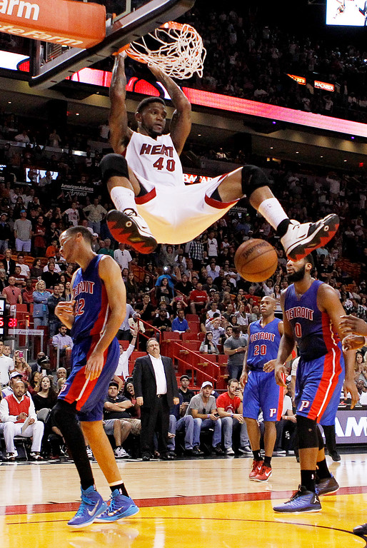 . Miami Heat forward Udonis Haslem (40) dunks in front of Detroit Pistons defenders Tayshaun Prince (22) and Andre Drummond during the second half of an NBA basketball game, Sunday, March 29, 2015, in Miami. The Heat won 109-102. (AP Photo/Joe Skipper)